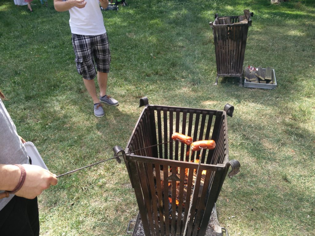 Grilling sausages in the park